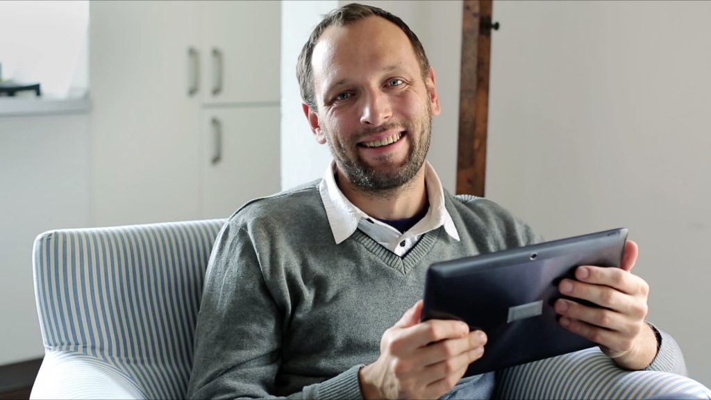stock footage portrait of young happy man with tablet computer at home 1024x576 - Certificado de segurança  SSL